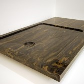 Brown marble showertray with straight standing area.
