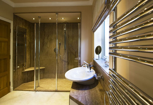 Luxury wetroom style bathroom with walk in shower and top mounted sink.
