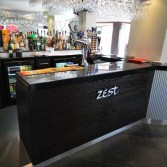 New bar installation with Versital solid surface top in 'Black Jaq'.