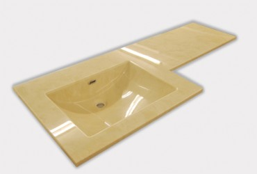 Cream marble vanity top with square integral bowl.