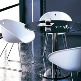 Black gloss round table with white chairs. Table base from inox 4401