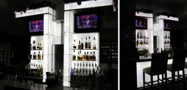 Back lit bar in white with black shelves.