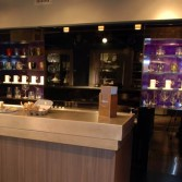 Purple sparkle high gloss decorative panels by Versital with bar in front.