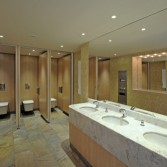 Marble vanity tops for a Commercial washroom with multiple sinks and toilets for public washroom.