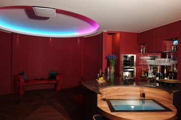 Games room with bar area in brown marble.
