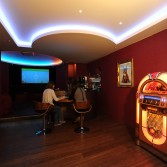 Bar area with jukebox - bar tops bespoke by Versital