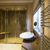Full bathroom and walk-in shower design created using Versital panels, tops and bespoke shower tray in 'Sandstone'.