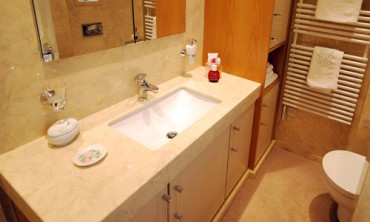 Cream limestone effect marble vanity top with ceramic undermounted basin