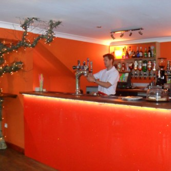 Bar panels in 'Tangoed' orange sparkle finish.