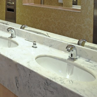 Washroom vanity top in 'Arabesque' marble finish.