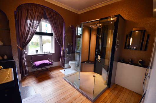 Beautiful master bathroom with a striking feature shower area using a made to measure shower tray in grey sparkle