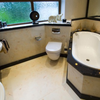 Family bathroom - using Versital panels, tops and floor slabs. 'Autumn Onyx' and 'Dusk'.