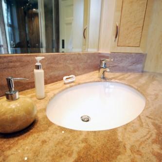 Vanity top in 'Sandstone' Granite finish.