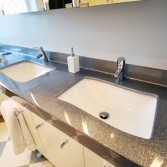 Silver vanity top with 2 white basins.