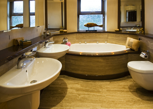 Cream granite style bathroom in cream finish 'Sandstone'.
