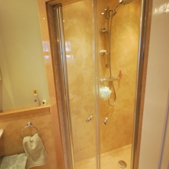 Shower panels in 'Bone' - in shower and surrounding bathroom.