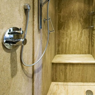 Shower area in 'Sandstone' with Bespoke shower tray.