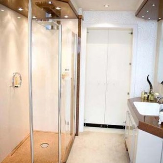 Walk in shower with panels in 'Ivory Pearl'