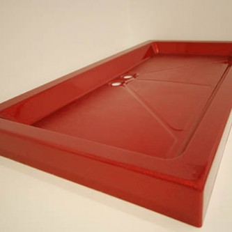 Bespoke red high gloss shower tray with 2 wastes.