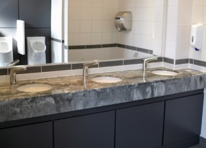 Grey stone granite style washroom vanity top with white basins