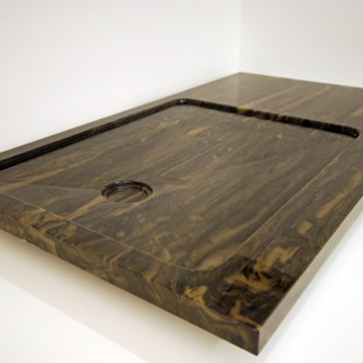 Bespoke shower tray in 'Wenge' brown marble finish.