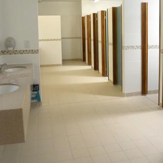 Washroom vanity top in 'Almond' granite finish.