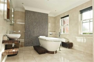 Luxury bathroom with marble tiles and free standing bath