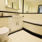 Bespoke luxury bathroom with black and white marble and granite finishes