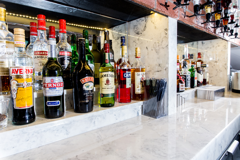 Marble back bar - carrara look faux marble.