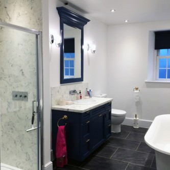 Carrara style marble shower and vanity