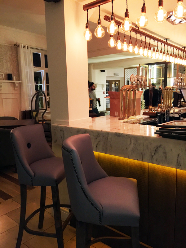 White marble bar top and purple poseur chairs