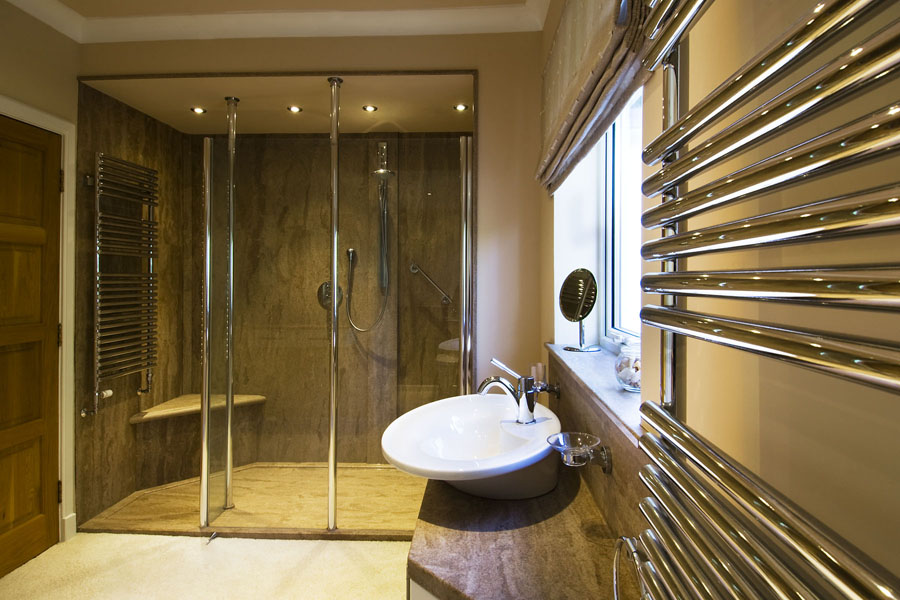 bathroom design using Versital sandstone marble finish shower panels and bespoke shower tray
