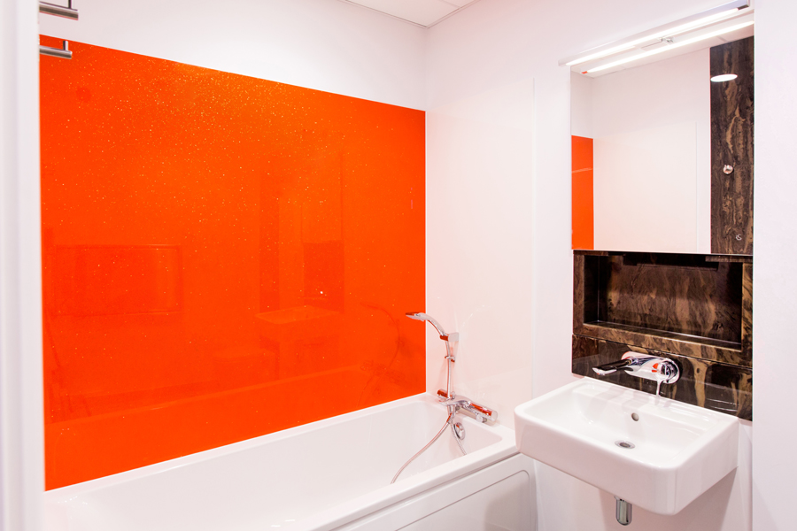 Bright orange bespoke stone resin shower panels