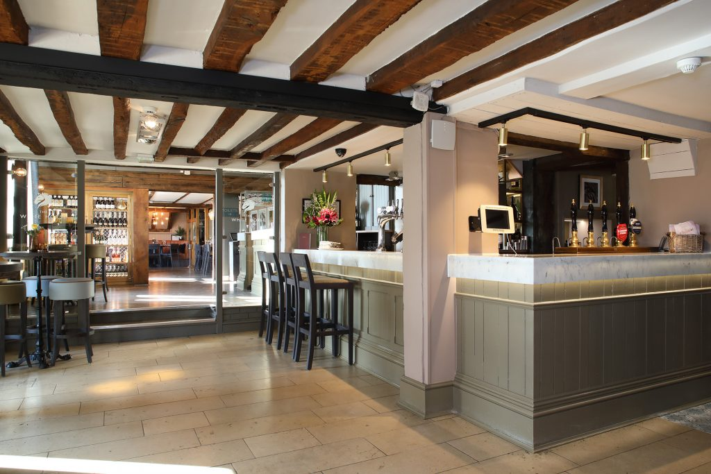 White horse pub Mitchells and Butlers using Versital marble bar tops