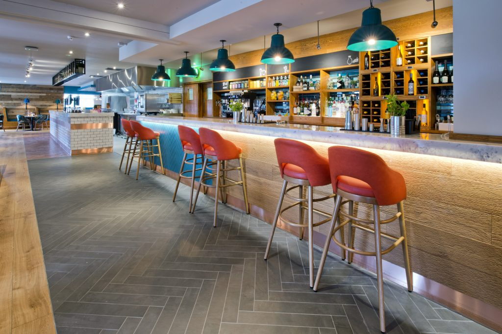 Whitbread latest brand roll out Cookhouse & Pub featuring marble bar tops from Versital