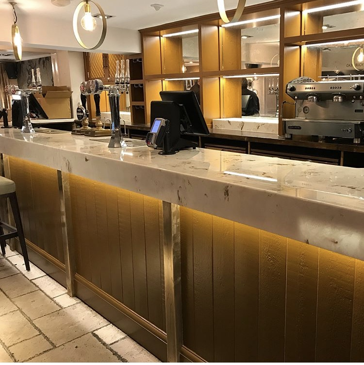 Metallic marble Gold Stratos bar top for Mitchells and Butlers The Fox at Harpenden.