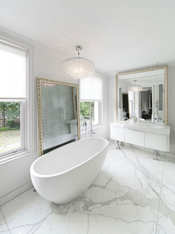 Free standing bath with marble floor surround for a beautiful marble bathroom
