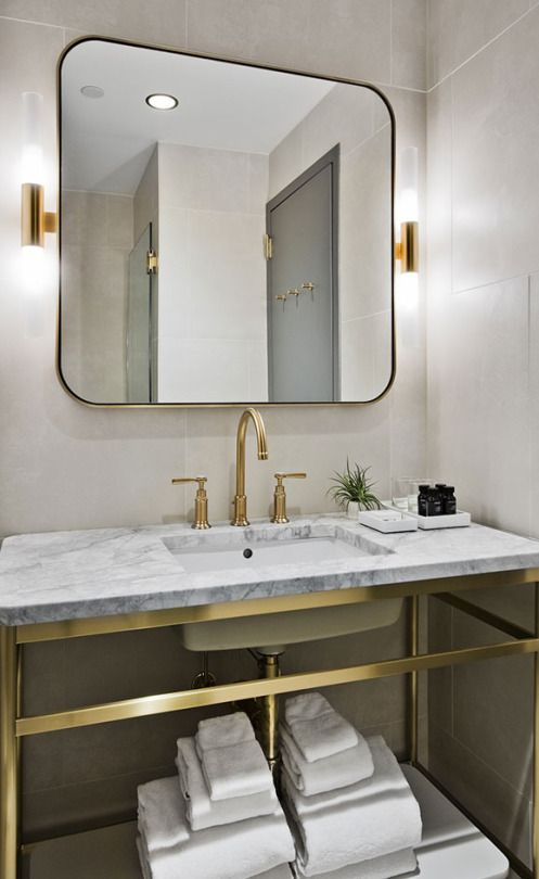 Grey marble bathroom vanity with brass accents inspiration from 11Howard.com