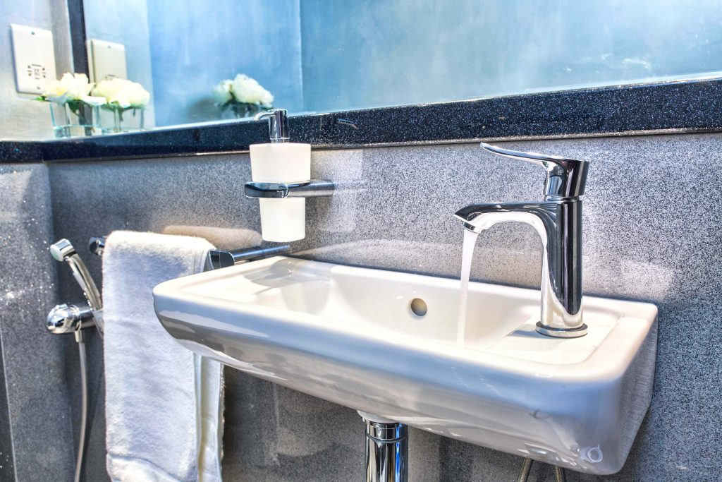 Bathroom wall panels in granite finish with sparkly shelf