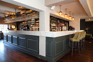 bar top in arabesque marble finish with a large drop edge
