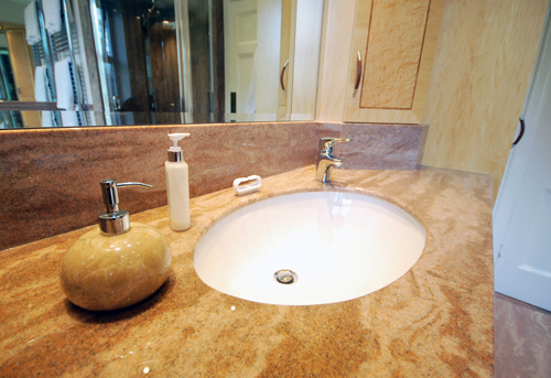 Cream and brown granite vanity top in Sandstone with undermounted ceramic basin.