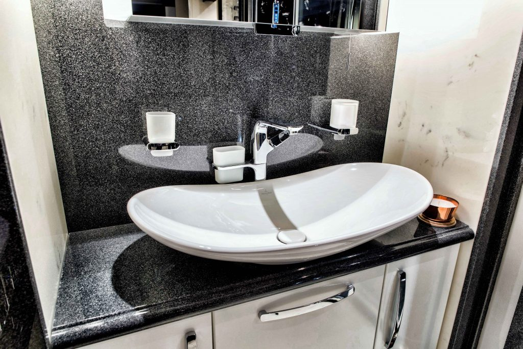 Granite vanity top with a top mounted sink