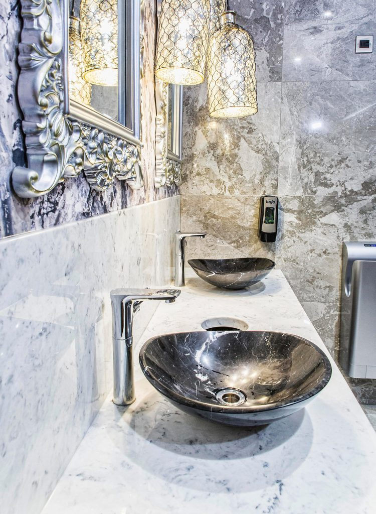 Stylish vanity top in arabesque marble with top mounted basins
