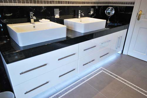 Dark vanity top with contrasting white high gloss cabinet