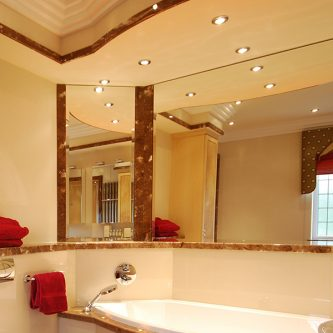 Bath Deck, Skirting and Decorative Panels in Coffee Creme Marble Finish and Wall Panels and Wall Panels in Ivory Pearl Reflect Finish
