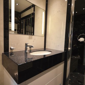 Bathroom Wall Panels in Arabesque Marble Finish and Vanity Top and Decorative Panels in Noire Reflect Sparkle Finish
