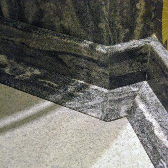 Floor Slab in Mercury Granite Finish and Skirting and Wall Panels in Gritstone Granite Finish