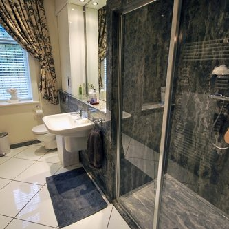 Shower Panel, Shower Tray and Wall Panels in Gritstone Granite Finish