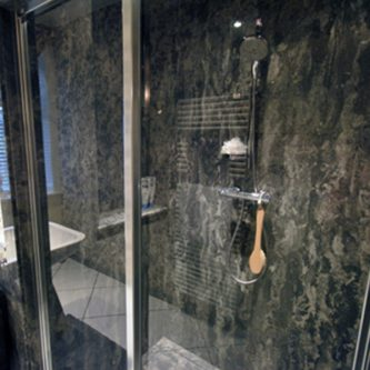 Shower Panels and Shower Tray in Gritstone Granite Finish
