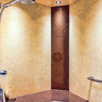 Shower Panels in Botticcino Marble Finish and a Shower Seat and Decorative Panels in Coco Loco Sparkle Finish